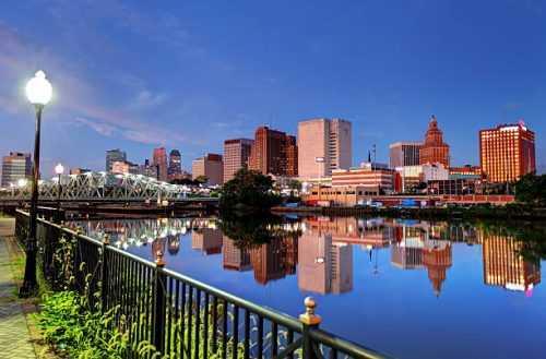 waterfront Newark, clear blue sky, buildings, water