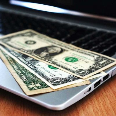 Cash on a laptop - search the web wisely for cheap NJ movers.