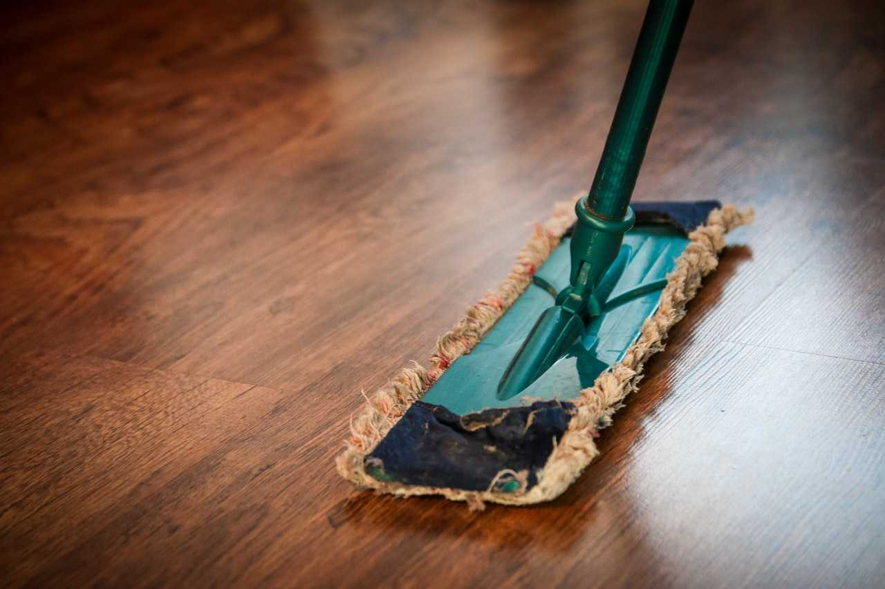A mop used for cleaning a wooden floor