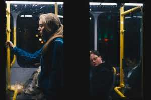 Four people using public transportation at night
