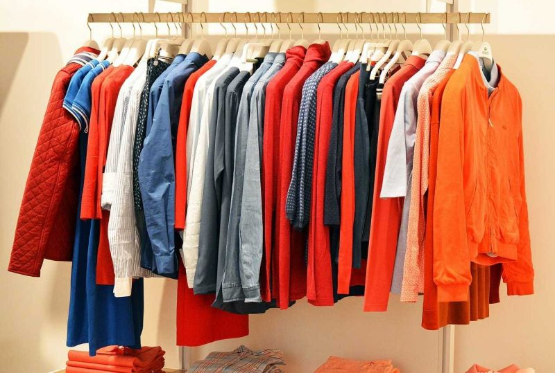 Bunch of clothes on a hangar - packing your clothes like a pro with Vector Movers NJ.