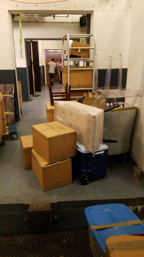 Different goods wrapped and packed in boxes ready to be moved by movers Bloomfield NJ