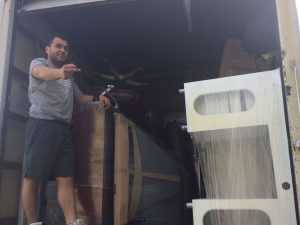 A man on a moving truck, loading furniture - working for one of the good moving companies Newark NJ
