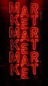 "Neon sign that says ""market"""