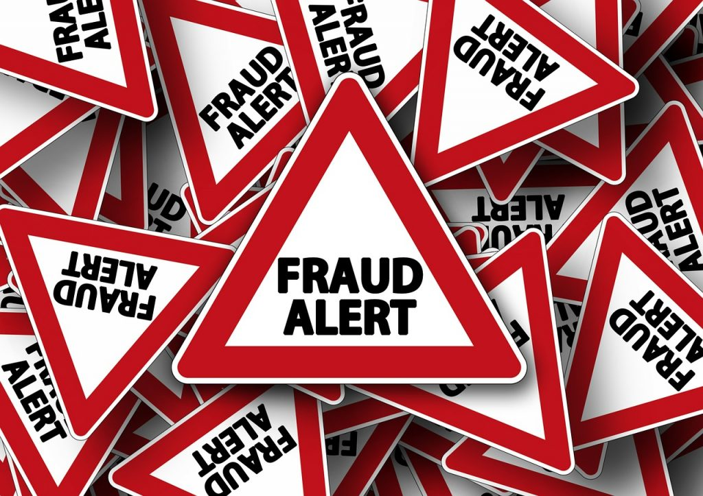"""A lot of road signs saying """"FRAUD ALERT"""""""