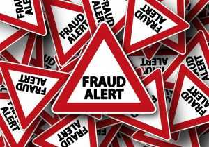 "A lot of road signs saying ""FRAUD ALERT"""