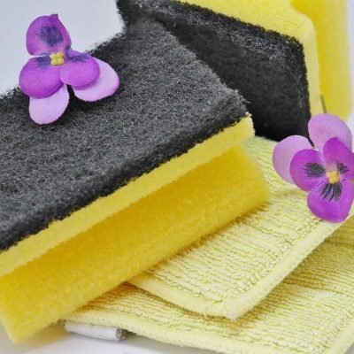 Two purple flowers, two yellow sponges and a yellow towel