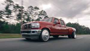 Large red moving pick-up truck