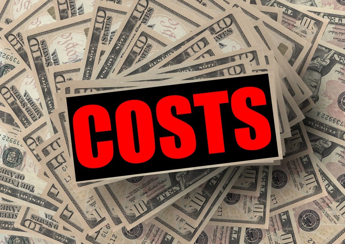 "The word ""costs"" and 10-dollar bills in the background"