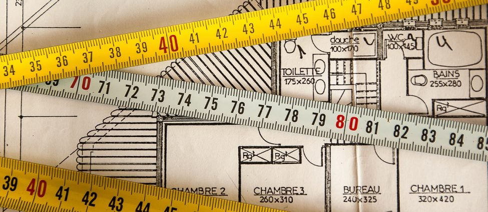 Measuring tapes and a house plan