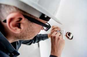 Electrician repairing the electric socket