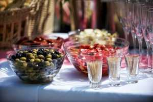A house party as a way to reward friends for helping you move - Bowls full of food, glasses and toothpicks on a table